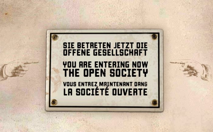 """Schild mit der Aufschrift """"Sie betreten jetzt die offene Gesellschaft"""""""
